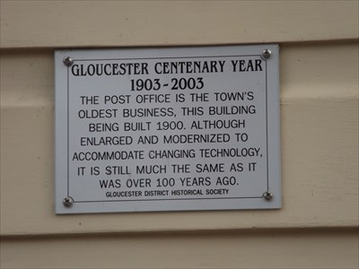 A sign on the wall of the Post Office.