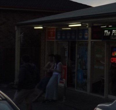 Cropped photo of the store, from an