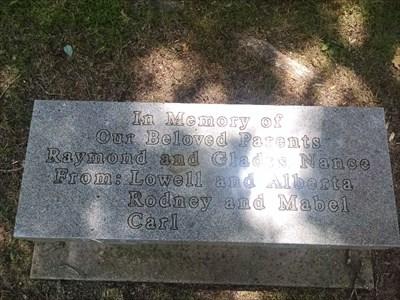 Raymond and Gladys Nance dedicated bench, by MountainWoods