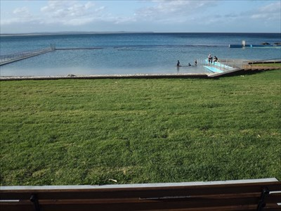 The view from over the top of the wooden bench. Looking over Forster Ocean Baths.