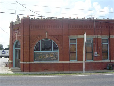 "2010 photo with ""Ponder State Bank"" glass in place.  Note ""Ponder Boot Co."" over the entrance."