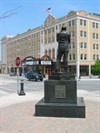 Statue Back with view of Genesee Theater where Jack Benny performed.