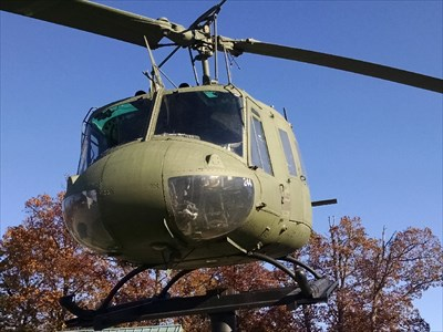 """Bell UH-1 """"Huey"""" at Holiday Island Veterans Memorial Park, by MountainWoods.  Close-up of front showing the number 244 on the lower window."""