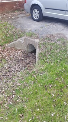 LECLAIR 2 RM03 facing southwest from the roadside, disk set in concrete of the driveway culvert