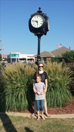 2/3 of my kids visiting the R.S.V.P. Clock in Enid, OK at Champlin Park.