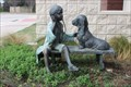 Image for Child Examining Dog - Farmers Branch, TX