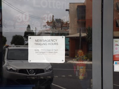 Sign on the door for the Newsagency Hours