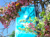Adams Park banner with spring trees in bloom