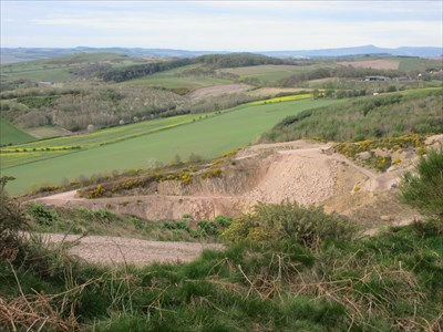 Looking down into the quarry from near the summit of Lucklaw Hill.