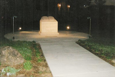 marker behind this monument in sidewalk