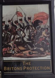 This new pub sign shows an 1819 event when local militia charged a crowd of unarmed demonstrators seeking parliamentary reform.