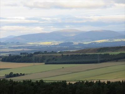 Looking over Strathmore to the foothills of the Grampian Mountains. The rounded summit is Catlaw with the more pointed Mount Blair to the left.