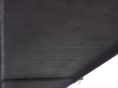 Close view of the concrete under-surface of the Spike Milligan pedestrian bridge, and how the Suspension Stays are held under the bridge.