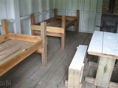 Bunks and table inside the reconstructed barracks for officers