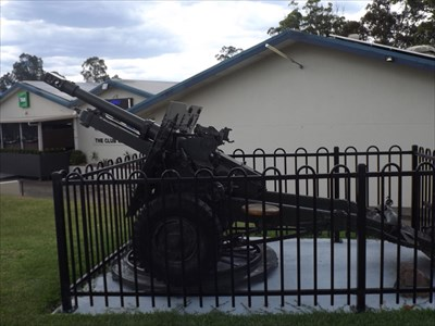 Side-view of this fenced piece of artillery, out the front of the Wangi RSL.