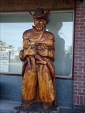 Image for Cowboy Holding Calf - Sedro-Woolley, WA
