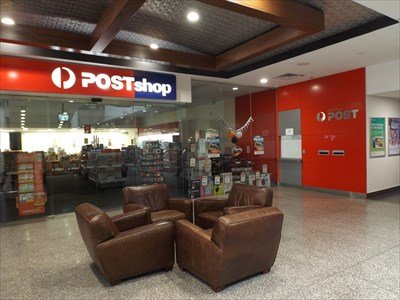 The Post Shop, with the corridor with the Postal Boxes on the far right of the photo.