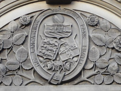 At the top is part of the arms of Manchester, the origin of the company, the left is from the arms of Lancaster, the county town of Lancashire and the right is from the arms of York, the county town of Yorkshire