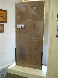This door is on display in the Visitor Center. It was taken from the Innis House and shows the damage from bullet holes.