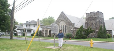geotrooperz-gm at the Halls Cross Roads marker in Aberdeen, Harford County, Maryland.  Grace United Methodist Church is in the background.