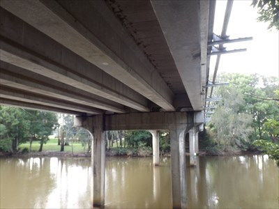 A view of the supporting beams, with the concrete pylons in the River.