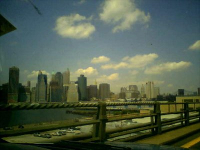 I took this on my camera phone while driving on the BQE. You can see the Brooklyn Bridge in the far right corner. Kinda bad quality, but I tried :)