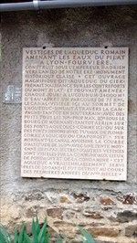 The engraved text on this plaque tells the history of the site