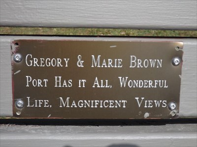 The anodised aluminium plaque, on the wooden slat bench overlooking the ocean at Port Macquarie, on the North Coast of NSW. 1208, Sunday, 11 September, 2016