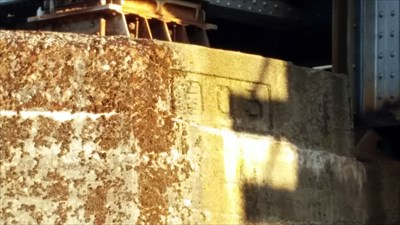 A date marker seen in the west concrete column of the bridge