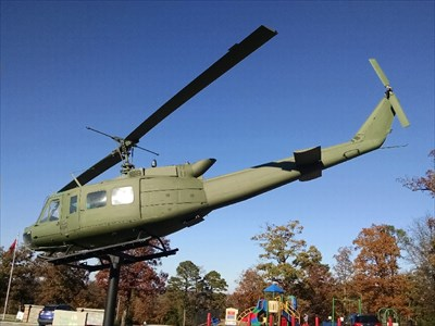 """Bell UH-1 """"Huey"""" at Holiday Island Veterans Memorial Park, by MountainWoods.  Tail shot."""