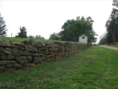 A modern day view of the Innis House where it sits on Sunken Road along the stone wall. This section of the wall is original.