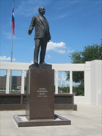 Statue of George Bannerman Dealey, with the new Margaret Hunt Hill Bridge peeking out in the background.
