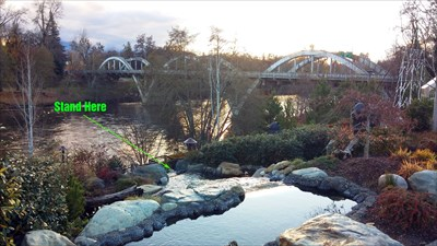 Picture of Caveman Bridge and arrow pointing to where you need to stand to get in the webcam video stream