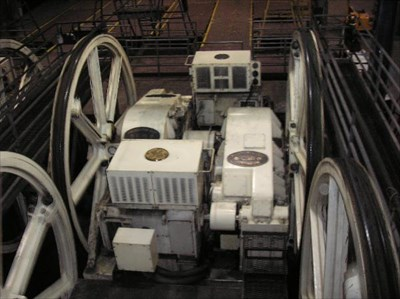 This photo actually shows two sets of motors powering two cables.  The motors are located under the box with a 'GE' emblem on top of it.