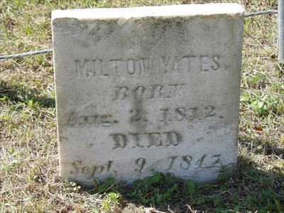 The Milton Yates marker is erect and well preserved, and the grave is surrounded by a crude fence consisting of four corner metal pipes held together by several strands of heavy wire;