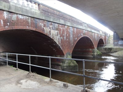 View of the bridge from under the modern concrete bridge that forms a slip road to the M60 motorway.