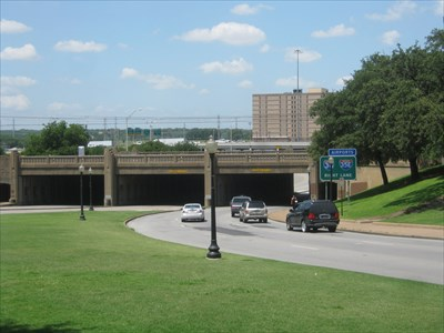 Looking across the plaza towards the triple underpass, with the grassy knoll to the upper right.