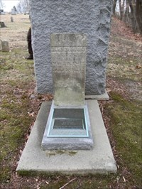 behind monument and another marker