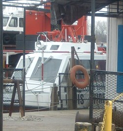 The fireboat is docked on a commerial dock and its view is often obscured.