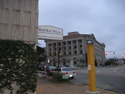 View of the WWII Memorial and the Federal Courthouse from the side of the building under the sign.