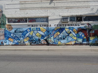 The Rio Linda Centennial mural is on the south side of the same building. This mural is also a Waymark.