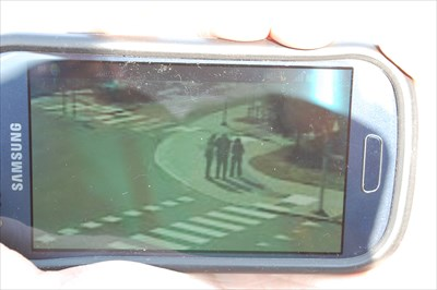 Me, my father and mother on the webcam. It is hard to se because of the webcam and when it is a photo of the phone screen