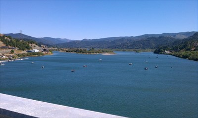 View of the Rogue River from Patterson Bridge looking east (inland). Lots of fishermen below trolling for Fall Salmon.