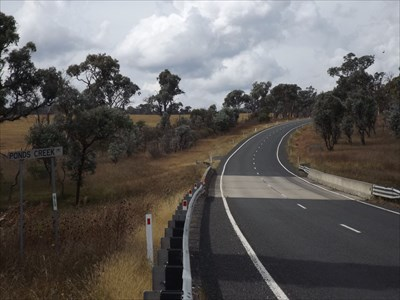 Looking East along Waterfall Way, NSW, with the western end plaque visible on the right.