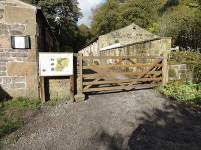 The building through the gate is the saw mill that used to be powered by water from Eller Beck that runs through the wood.