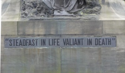 The inscription below the figure of Northumbria