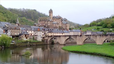 The four arched bridge is in the forground. The Chateau d