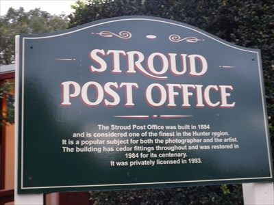 A sign beside the Post Office, of the history of the building.