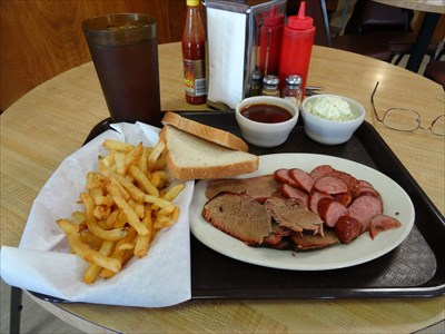 Sausage, brisket, fries, and slaw, with an iced tea to wash it down.