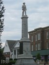 A Confederate soldier stands with musket on top of the monument.